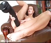 Nasty girl plays with gigantic dildo