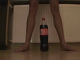 Nympho and coke 2 liter bottle