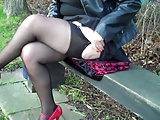 Black seamed fishnet stockings and Red Heels