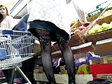 Girl in fashion fishnet stockings in market